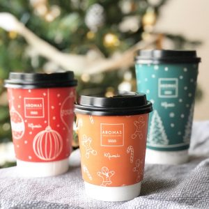 Christmas coffee cup artwork and design for Aromas artisan cafe in Weybridge UK by small business designer Kerri Awosile