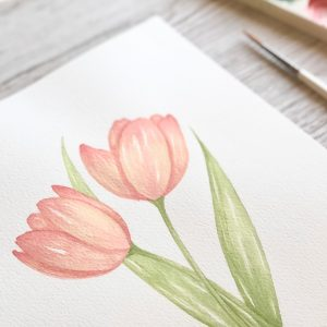 Watercolour Tulip painting on desk with brush and paint palette by brand artist Kerri Awosile